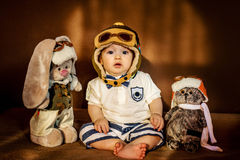 Young aviator and his friends. Stock Photos
