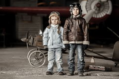 Young aviators. In homemade aircraft in a large hangar Royalty Free Stock Image