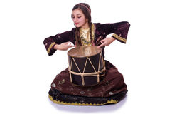 Young azeri woman. Playing traditional drum nagara royalty free stock image