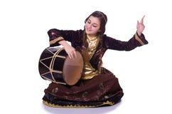 Young azeri woman. Playing traditional drum nagara royalty free stock photo