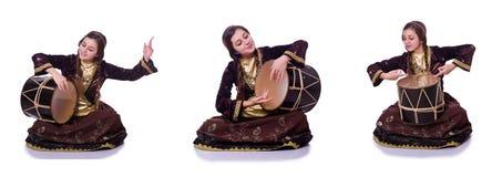 The young azeri woman playing traditional drum nagara. Young azeri woman playing traditional drum nagara royalty free stock photography
