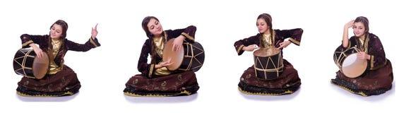 The young azeri woman playing traditional drum nagara. Young azeri woman playing traditional drum nagara royalty free stock image