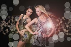 Young babes on disco. Two young babes on disco royalty free stock images
