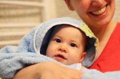 Young baby in bathrobe Royalty Free Stock Images