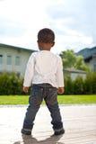 Young baby boy in the garden Stock Photos
