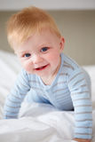Young Baby Boy Playing In Bed. Close Up Of Young Baby Boy Playing In Bed Stock Image