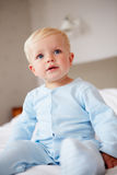 Young Baby Boy Playing In Bed Royalty Free Stock Images