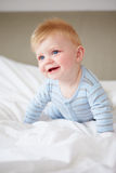 Young Baby Boy Playing In Bed Royalty Free Stock Photography
