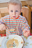 Young baby boy with spoon Royalty Free Stock Photo