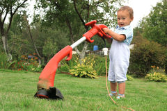 Young baby boy with trimmer Royalty Free Stock Images