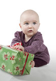 Young baby with gift Royalty Free Stock Photography