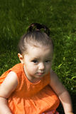 Young baby girl. Sitting in the park Royalty Free Stock Images