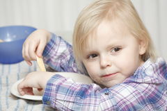 Young baby girl eating breakfast sandwich Royalty Free Stock Image