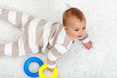 Young baby girl on the floor Stock Photos