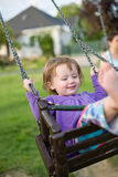 Young baby girl in the playground. Royalty Free Stock Photography