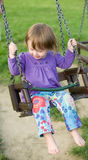 Young baby girl in the playground. Stock Photos