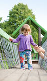 Young baby girl in the playground. Royalty Free Stock Photo