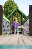 Young baby girl in the playground. Stock Photo