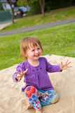 Young baby girl in the playground. Royalty Free Stock Image