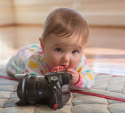 Young baby girl playing with camera Stock Image
