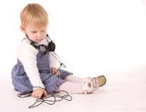 Young baby girl wearing phone headset Stock Photos