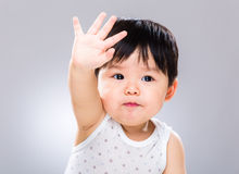 Young baby greeting with hand Stock Photos