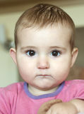 Young baby, head and shoulders shot, with great expression on her face. Stock Photography