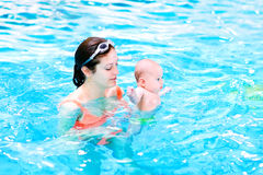 Young baby with his mother in swimming pool Royalty Free Stock Image