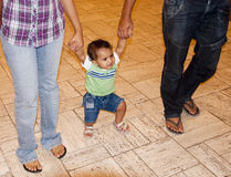 Young baby learning to walk Stock Photography