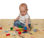 Young baby playing with educational toys royalty free stock photo
