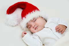 Young baby in a Santa Claus hat Royalty Free Stock Images