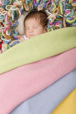 Young baby sleeping Stock Images