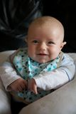 Young Baby Smiling. With bib on stock photo