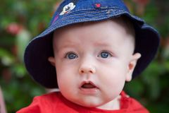 Young Baby Smiling. With hat on stock images