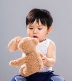 Young baby son hold with doll bear Stock Photo