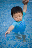 Young baby in the swimming pool Stock Image