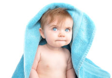 Young Baby Under Blue Towel on White Royalty Free Stock Images