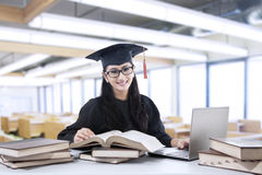 Young bachelor studying in library Royalty Free Stock Photos