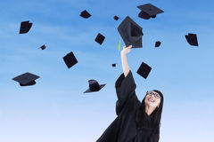 Young bachelor throw graduation cap Stock Photography
