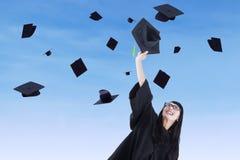 Young bachelor throw graduation cap Stock Photography