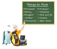 Young backpacker check things to pack on blackboard Stock Photos