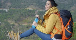 Young backpacker pausing for water stock video footage