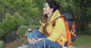 Young backpacker pausing for water stock footage