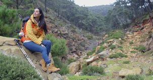 Young backpacker relaxing to enjoy the view stock footage