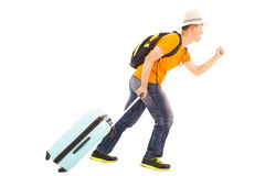 Young backpacker running happily to travel worldwide. Over white royalty free stock photography