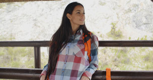 Young backpacker standing on a mountain lookout Royalty Free Stock Photography