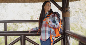 Young backpacker standing on a mountain lookout Royalty Free Stock Images