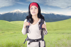 Young backpacker standing outdoors Stock Image