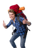 Young backpacker tourist giving thumbs up carrying backpack ready for travel Stock Photo