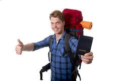 Young backpacker tourist holding passport carrying backpack ready for travel and adventure Royalty Free Stock Image